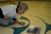 Vanessa painting labyrinth at St Luke's Church